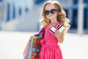 little girl shopping with credit cards