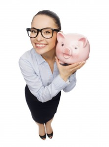 saving; how to save - smiling businesswoman in eyeglasses with piggy bank